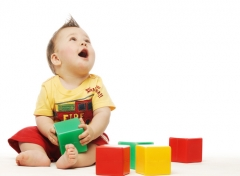 baby_looking_up_with_play_bricks